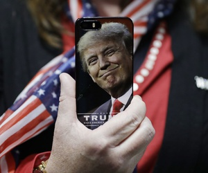 A woman holds up her cell phone before a rally with Republican presidential candidate Donald Trump, Thursday, Sept. 29, 2016, in Bedford, N.H. AP Photo/John Loche