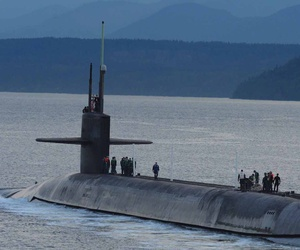 The ballistic-missile submarine USS Henry M. Jackson (SSBN 730) arrives home at Naval Base Kitsap-Bangor following a strategic deterrent patrol in 2015.