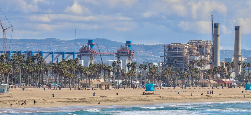 A desalinization plant sits just beyond the shoreline in Huntington Beach, California.