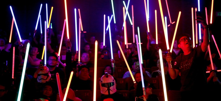 "These aren't the Jedi you're looking for. Star Wars fans raise their lightsabers before the starts of ""Star Wars: The Last Jedi"" movie in Subang Jaya, Malaysia, Friday, Dec. 15, 2017"