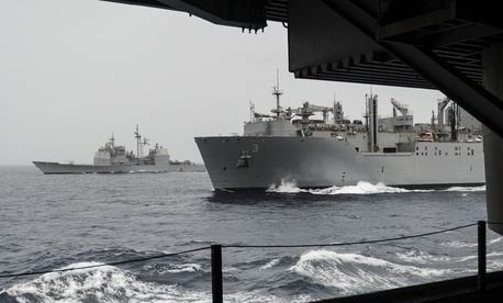 The guided-missile cruiser USS Princeton (CG 59), left, and the Military Sealift Command dry cargo ammunition ship USNS Alan Shepard (T-AKE 3) break away from the aircraft carrier USS Nimitz (CVN 68) after a replenishment-at-sea in 2013.