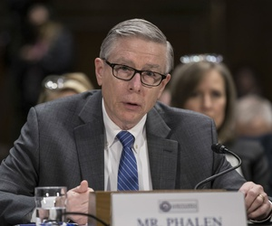 National Background Investigation Bureau Director Charlie Phalen testifies before the Senate Intelligence Committee in March 2018.