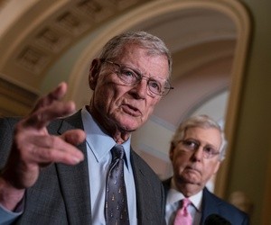 Senate Armed Services Committee Chairman Jim Inhofe, R-Okla., joined at right by Senate Majority Leader Mitch McConnell, R-Ky.