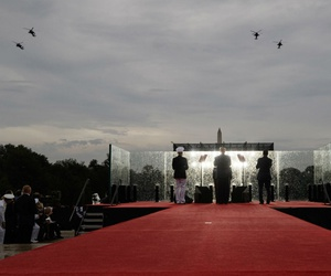 President Trump, joined by acting Secretary of Defense Mark Esper, right, and Joint Chiefs Chairman Gen. Joseph Dunford, left, stands on stage during the July 4 military flyover in Washington.