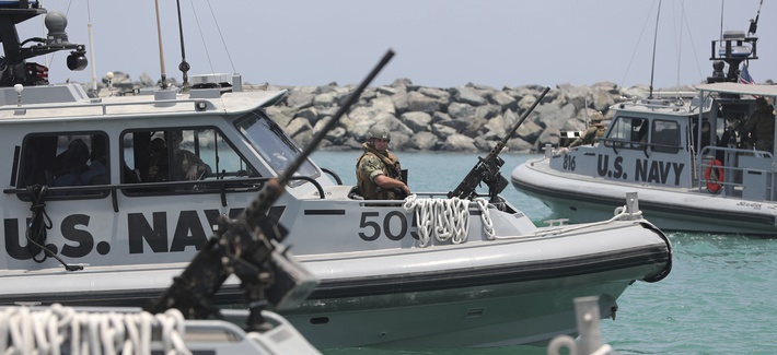 U.S. Navy patrol boats carrying journalists to see damaged oil tankers leaves a U.S. Navy 5th Fleet base near Fujairah, United Arab Emirates, Wednesday, June 19, 2019.
