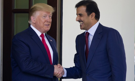 President Donald Trump shakes hands as he welcomes Qatar's Emir Sheikh Tamim bin Hamad Al Thani upon his arrival at the White House, Tuesday, July 9, 2019, in Washington.