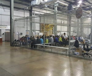 U.S. Border Patrol agents conduct intake of border crossers at the Central Processing Center in McAllen, Texas, Sunday, June 17, 2018.