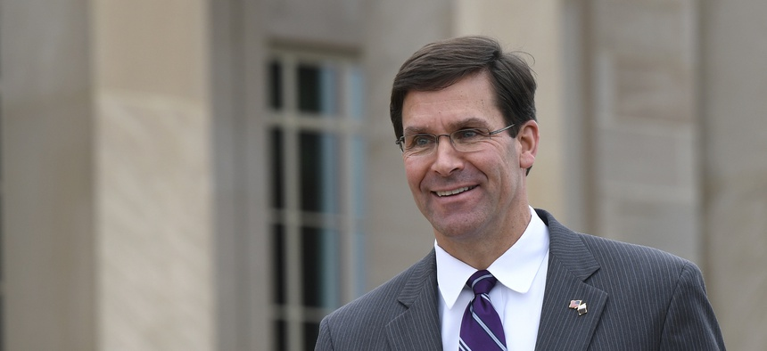In this July 8, 2019, photo, acting Secretary of Defense Mark Esper waits for the arrival of Qatar's Emir Sheikh Tamim bin Hamad Al Thani to the Pentagon.