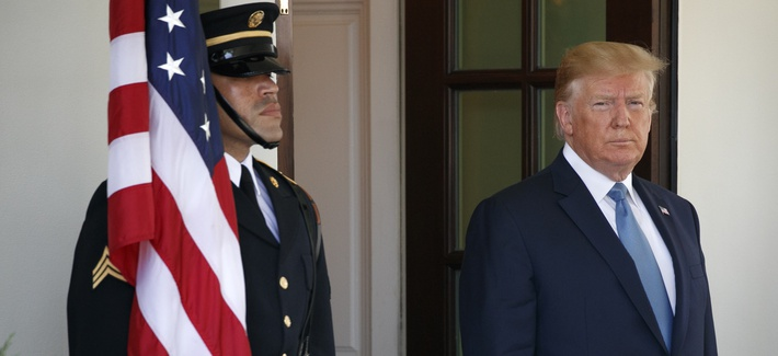 President Donald Trump waits to greet Pakistan's Prime Minister Imran Khan as he arrives at the White House, Monday, July 22, 2019, in Washington.