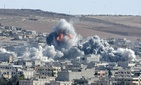 Coalition forces hitting an ISIS target in Syria's Kobani district on October 22, 2014.