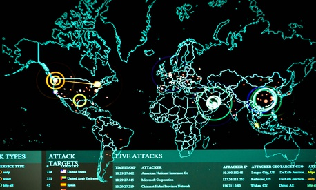 Real-time cyber attacks are displayed in 2017 on the 275th Cyberspace Squadron's operations floor, known as the Hunter's Den, at Warfield Air National Guard Base, Middle River, Md.