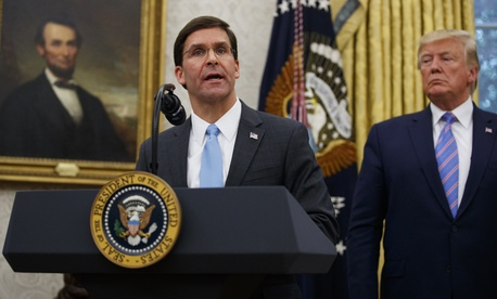 President Donald Trump looks to Secretary of Defense Mark Esper during a ceremony in the Oval Office at the White House in Washington, Tuesday, July 23, 2019.