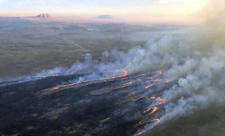 Wildfires burn in Idaho on July 24, 2019, on Idaho National Laboratory grounds. The fires were approaching buildings that contain nuclear fuel and other radioactive material until a wind change.