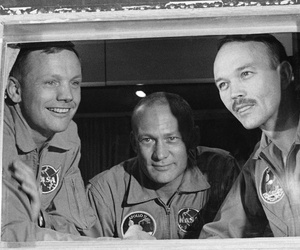 In this July 27, 1969 file photo, Apollo 11 crew members, from left, Neil Armstrong, Buzz Aldrin and Michael Collins sit inside a quarantine van in Houston.