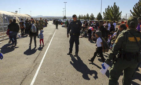 This May 29, 2019, photo released by U.S. Customs and Border Protection (CBP) shows some of 1,036 migrants who crossed the U.S.-Mexico border in El Paso, Texas, the largest that the Border Patrol says it has ever encountered.
