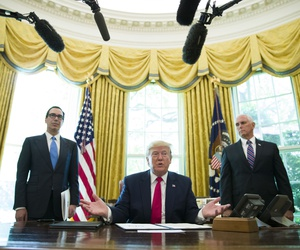 President Donald Trump after signing an executive order to increase sanctions on Iran, in the Oval Office, Mon., June 24, 2019, in Washington. Trump is accompanied by Treasury Secretary Steve Mnuchin, left, and Vice President Mike Pence.