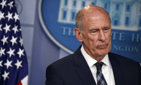 Director of National Intelligence Dan Coats listens during the daily press briefing at the White House, Thursday, Aug. 2, 2018, in Washington.