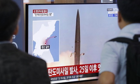 People watch a TV showing a file image of North Korea's missile launch during a news program at the Seoul Railway Station in Seoul, South Korea, Wednesday, July 31, 2019.