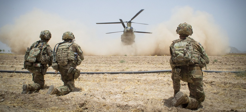Paratroopers assigned to the 3rd Brigade Combat Team, 82nd Airborne Division secure a helicopter landing zone for a CH-47 Chinook Helicopter on Saturday, July 20th in Kandahar Province, Afghanistan, on July 20, 2019.