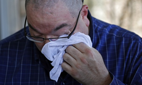 Paul Jamrowski wipes away tears as he speaks with the media about the death of his daughter at University Medical Center of El Paso, Sunday, Aug. 4, 2019, in El Paso, Texas.