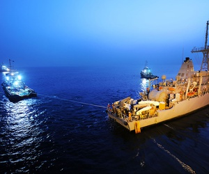 The USS Devastator, a Navy minesweeper, is pulled into position as it arrives in Bahrain in 20