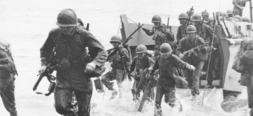In this Aug. 1942 file photo, U.S. Marines charge ashore on Guadalcanal Island from a landing barge during the early phase of the U.S. offensive in the Solomon Islands during World War II.