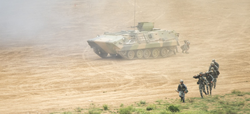 People's Liberation Army troops demonstrate an attack during a visit by Marine Corps Gen. Joe Dunford, the chairman of the Joint Chiefs of Staff, to China, Aug. 16, 2017.