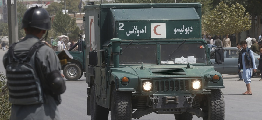 An Afghan military ambulance rushes towards the site of an explosion that wounded dozens of people in Kabul, Afghanistan, on Aug. 7, 2019. The Taliban claimed responsibility for the attack.