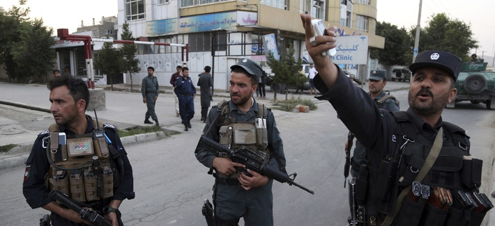 Afghan security personnel secure the site of a deadly attack in Kabul, Afghanistan, Sunday, July 28, 2019.