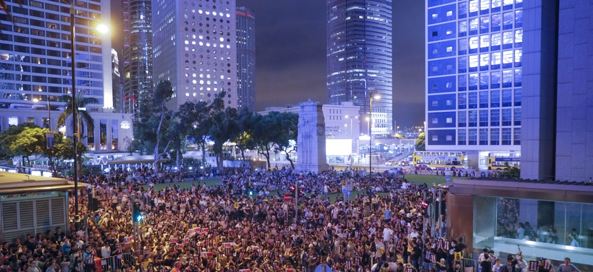 Pro-democracy protesters gather to participate in a rally organized by higher education students in Chater Garden in Hong Kong Friday, Aug. 16, 2019.