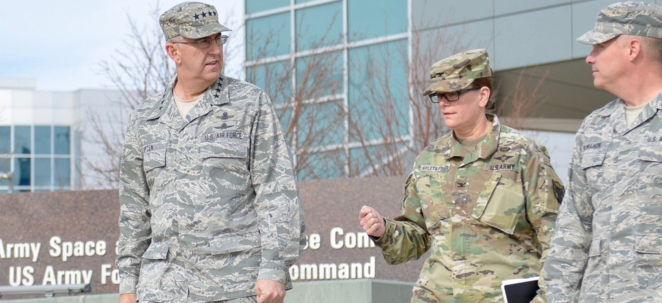 U.S. Air Force Gen. John Hyten, commander of U.S. Strategic Command, left, walks with U.S. Army Col. Kathryn Spletstoser, then director of his commander's action group director at  U.S. Army Space and Missile Defense Command in November 2017.