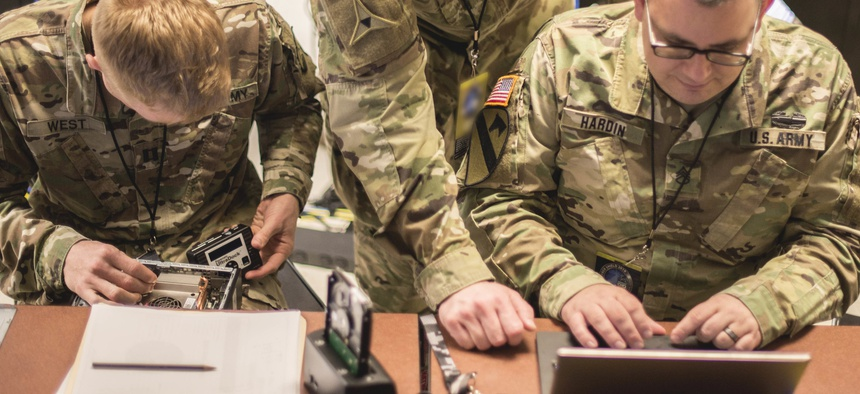 Members of the Illinois National Guard practice digital forensic skillsets during a Cyber Shield 19 training week class at Camp Atterbury, Ind. April 7, 2019.
