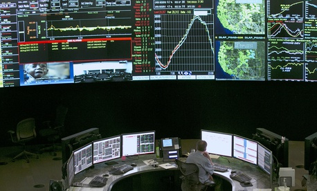 In this 2017 photo, electrical power flow and conditions are monitored at the California Independent System Operator grid control center, in Folsom, Calif.
