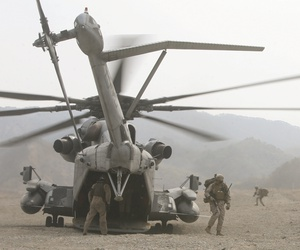 U.S. Marines exit CH-53E Super Stallion helicopters as part of the vertical assault raid portion of exercise Ssang Yong 2014 at Su Seong-Ri Range in Pohang, Republic of Korea, in 2014.