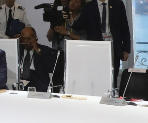 French, Egyptian, Chilean, and German leaders attend a work session on climate on the third day of the annual G7 Summit. The empty seat at third right was the place reserved for U.S. President Donald Trump. (Ludovic Marin, Pool via AP)