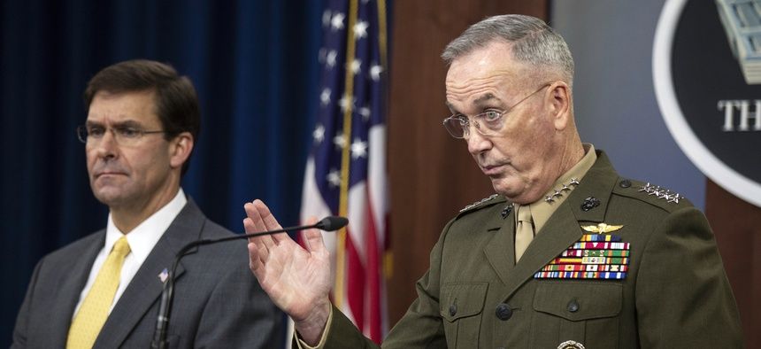 Joint Chiefs Chairman Gen. Joseph Dunford with Secretary of Defense Mark Esper speaks to reporters during a briefing at the Pentagon, Wednesday, Aug. 28, 2019