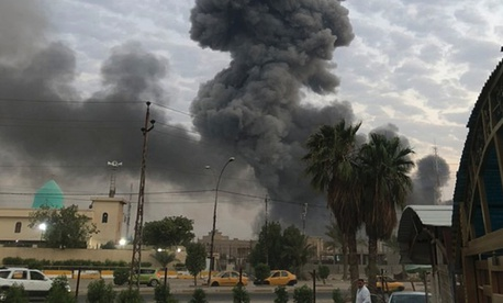 On Aug. 12, 2019, plumes of smoke rise after an explosion at a military base southwest of Baghdad, Iraq.