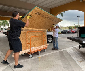 Shoppers in Pembroke Pines, Florida, buy plywood to board up windows before Dorian's landfall.