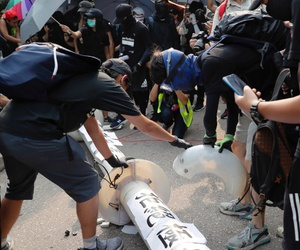 Demonstrators put papers on a fallen smart lamppost during a protest in Hong Kong, Aug. 24.