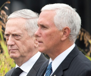 Mattis and Mike Pence walk together in 2018.