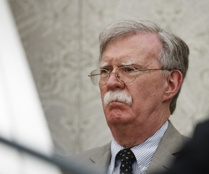 National security adviser John Bolton listens as President Donald Trump speaks during a meeting with Romanian President Klaus Iohannis in the Oval Office of the White House, Tuesday, Aug. 20, 2019, in Washington.