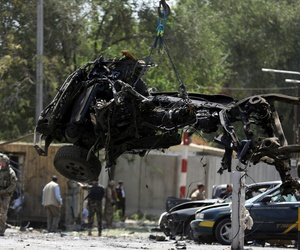 Resolute Support forces remove wreckage after the September 5 car-bomb explosion in Kabul.