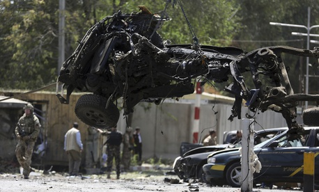 Resolute Support (RS) forces remove a destroyed vehicle after a car bomb explosion in Kabul, Afghanistan, Thursday, Sept. 5, 2019.