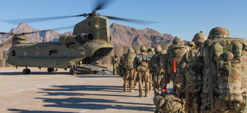 Soldiers assigned to the 101st Resolute Support Sustainment Brigade load onto a Chinook helicopter to head out and execute missions across Afghanistan, Jan. 15, 2019.