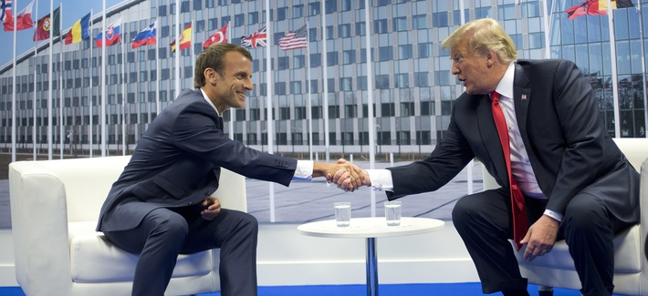 President Donald Trump and French President Emmanuel Macron shake hands during their bilateral meeting, Wednesday, July 11, 2018 in Brussels, Belgium.
