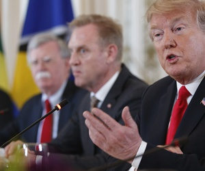 From left, National Security Adviser John Bolton, Acting Defense Secretary Patrick Shanahan, and President Donald Trump sit together during a meeting with Caribbean leaders at Mar-A Lago, Friday, March 22, 2019, in Palm Beach, Fla.