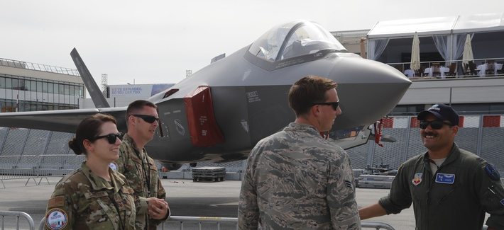 U.S Air Force crew members gather next to a F-35 Lightning II at Paris Air Show, in Le Bourget, east of Paris, France, Tuesday, June 18, 2019.