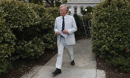 National security adviser John Bolton walks to speak to media at the White House in Washington, Wednesday, July 31, 2019.