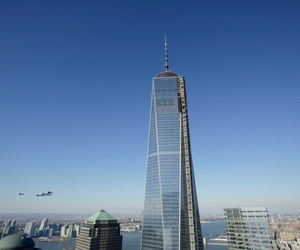 Seven F/A-18 Hornets, lower left, members of the U.S. Navy's Blue Angels flight demonstration team, approach One World Trade Center in 2013.