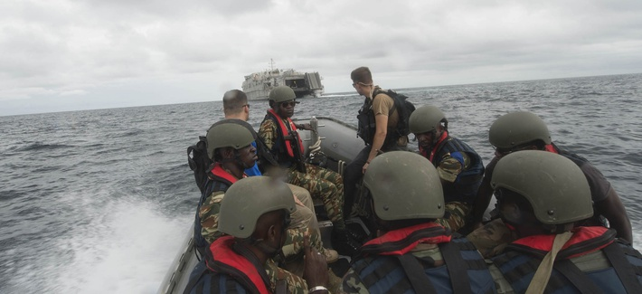 A rigid hull inflatable boat makes for USNS Spearhead in the Gulf of Guinea during a passenger exchange of Gabon Navy Sailors and Gendarmerie members during a boarding exercise, March 19, as part of Exercise Obangame/Saharan Express 2016.